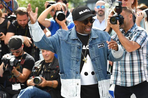 (Photo by Arthur Mola/Invision/AP). Director Spike Lee pose for photographers during a photo call for the film 'BlacKkKlansman' at the 71st international film festival, Cannes, southern France, Tuesday, May 15, 2018.