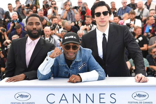 (Photo by Arthur Mola/Invision/AP). Actor John David Washington, from left, director Spike Lee, and Adam Driver pose for photographers during a photo call for the film 'BlacKkKlansman' at the 71st international film festival, Cannes, southern France, T...