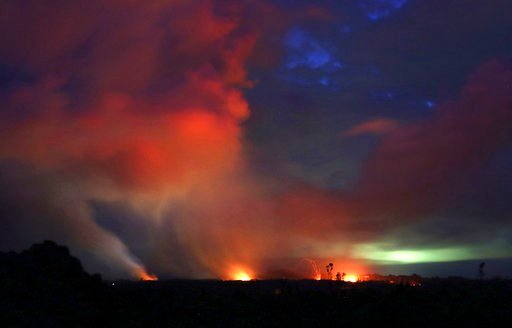 (AP Photo/Caleb Jones). Lava shoots into the night sky from active fissures on the lower east rift of the Kilauea volcano, Tuesday, May 15, 2018, near Pahoa, Hawaii.