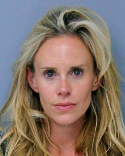 (St. Johns County, Florida, Sheriff's Office via AP). This Saturday, May 12, 2018 booking photo provided by St. Johns County, Florida, Sheriff's Office shows Krista Glover, the wife of former U.S. Open champion Lucas Glover.  She was arrested on charge...