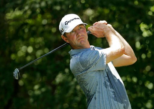 (AP Photo/Chuck Burton, File). FILE - In this Aug. 20, 2016 file photo, Lucas Glover watches his tee shot on the second hole during the third round of the Wyndham Championship golf tournament in Greensboro, N.C. The wife of the former U.S. Open champio...