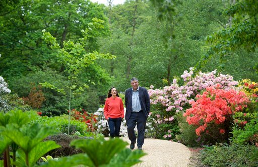 (Eddie Mulholland/Pool Photo via AP). Floral designer Philippa Craddock, and Keeper of the Gardens John Anderson are photographed in the Savill Garden, in Windsor Great Park, Windsor, England, Wednesday, May 16, 2018, as they look at leaves to be used ...
