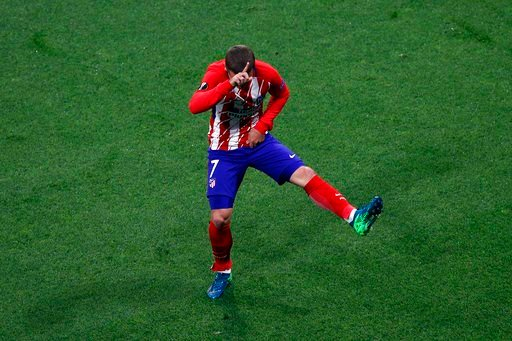 (AP Photo/Christophe Ena). Atletico's Antoine Griezmann's celebrates his side opening goal during the Europa League Final soccer match between Marseille and Atletico Madrid at the Stade de Lyon outside Lyon, France, Wednesday, May 16, 2018.