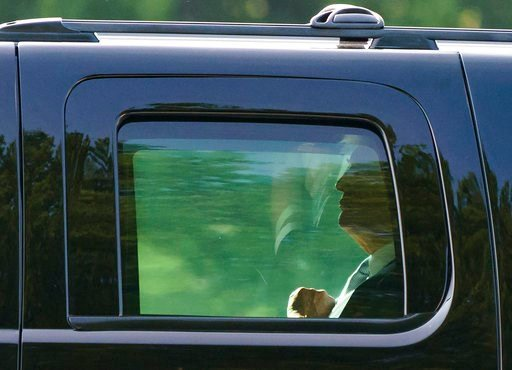 (AP Photo/Carolyn Kaster). President Donald Trump is seen through the window of his motorcade vehicle as he is driven to board Martine One at Walter Reed National Military Medical Center in Bethesda, Md., Tuesday, May 15, 2018, en route to Washington. ...
