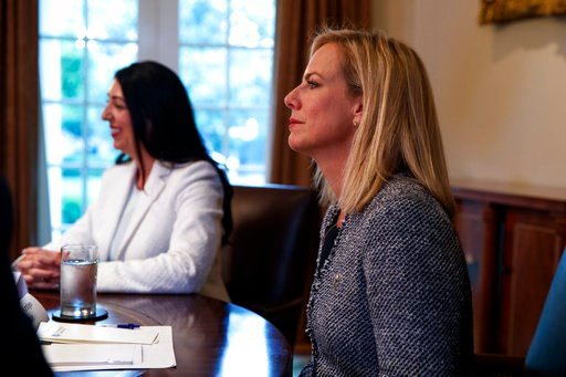 (AP Photo/Evan Vucci). Secretary of Homeland Security Kirstjen Nielsen listens as President Donald Trump speaks during a roundtable on immigration policy in California, in the Cabinet Room of the White House, Wednesday, May 16, 2018, in Washington.