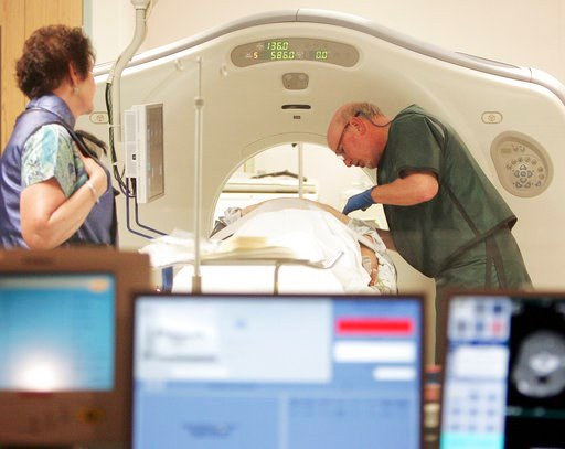 (AP Photo/Jim Cole, File). FILE - In this June 3, 2010, file photo, Dr. Steven Birnbaum works with a patient in a CT scanner at Southern New Hampshire Medical Center in Nashua, N.H. According to a study released on Wednesday, May 16, 2018, less than 2 ...