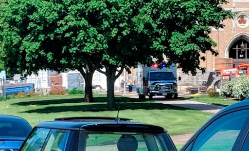 (Rachel Rogers/Sauk Valley Media via AP). An emergency vehicle appears outside Dixon High School Wednesday, May 16, 2018 in Dixon, Ill. Officials say a police officer has shot and wounded a gunman at a northern Illinois high school. The Dixon city mana...