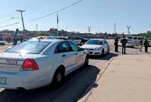 (Rachel Rogers/Sauk Valley Media via AP). Police cars appear outside Dixon High School Wednesday, May 16, 2018 in Dixon, Ill. Officials say a police officer has shot and wounded a gunman at a northern Illinois high school. The Dixon city manager Danny ...