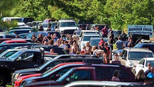 (Alex T. Paschal/Sauk Valley Media via AP). Parents wait down the road to meet their children following a shooting at Dixon High School Wednesday, May 16, 2018, in Dixon, Ill. A 19-year-old who showed up at his former high school in northern Illinois a...