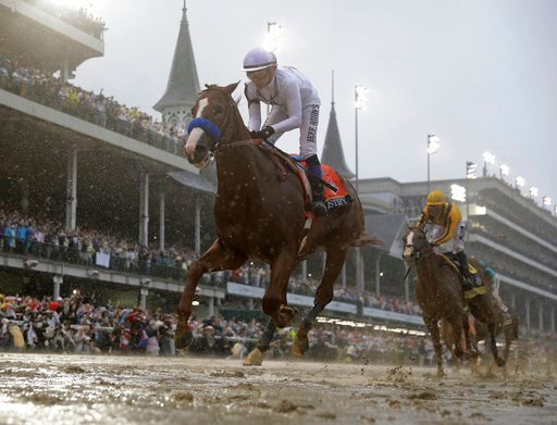 (AP Photo/Morry Gash). Mike Smith rides Justify to victory during the 144th running of the Kentucky Derby horse race at Churchill Downs Saturday, May 5, 2018, in Louisville, Ky.