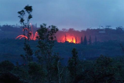 (AP Photo/Caleb Jones). Lava shoots into the night sky from active fissures on the lower east rift of the Kilauea volcano, Tuesday, May 15, 2018, near Pahoa, Hawaii.