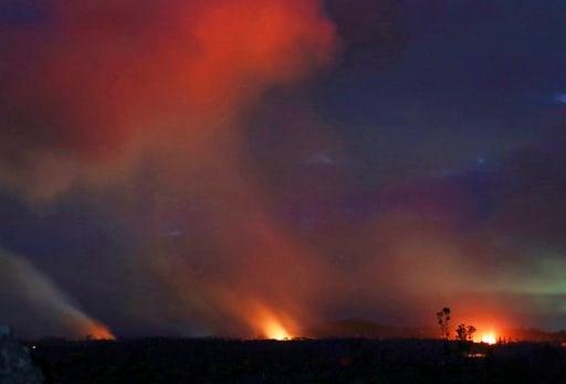 (AP Photo/Caleb Jones). Lava shoots into the night sky from active fissures on the lower east rift of the Kilauea volcano, Tuesday, May 15, 2018 near Pahoa, Hawaii.