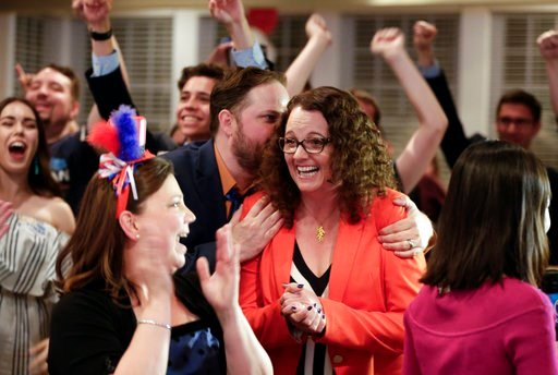 (AP Photo/Nati Harnik). Democratic 2nd District House candidate Kara Eastman is hugged by her campaign manager Ben Onkka, in Omaha, Neb., Tuesday, May 15, 2018, as she holds a slim lead over Brad Ashford in the primary election. Omaha-area voters are s...