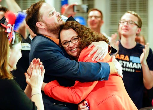 (AP Photo/Nati Harnik). Democratic 2nd District House candidate Kara Eastman hugs her campaign manager Ben Onkka, in Omaha, Neb., Tuesday, May 15, 2018, as she holds a slim lead over Brad Ashford in the primary election. Omaha-area voters are set to pi...
