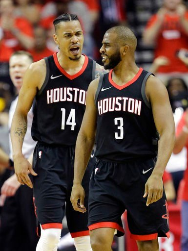 (AP Photo/David J. Phillip). Houston Rockets guard Chris Paul (3) celebrates a score with teammate Gerald Green (14) during the first half in Game 2 of the NBA basketball Western Conference Finals against the Golden State Warriors, Wednesday, May 16, 2...