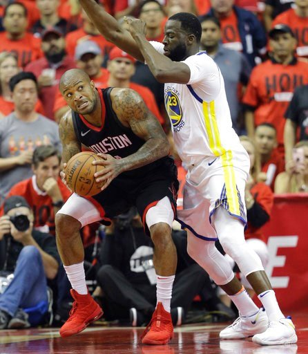 (AP Photo/David J. Phillip). Houston Rockets forward P.J. Tucker, left, is pressured by Golden State Warriors forward Draymond Green (23) during the first half in Game 2 of the NBA basketball Western Conference Finals, Wednesday, May 16, 2018, in Houst...