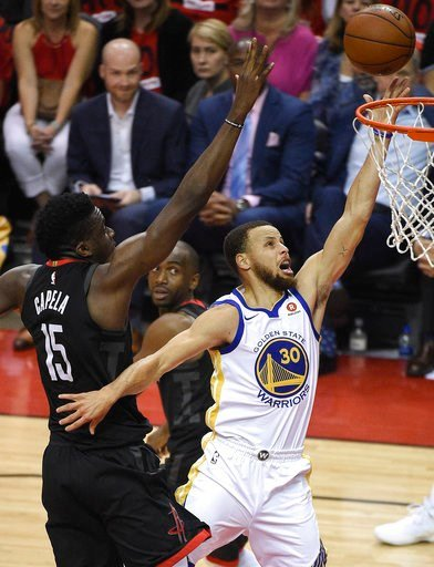 (AP Photo/Eric Christian Smith). Golden State Warriors guard Stephen Curry (30) drives to the basket as Houston Rockets center Clint Capela (15) defends during the first half of Game 2 of the NBA basketball playoffs Western Conference finals Wednesday,...