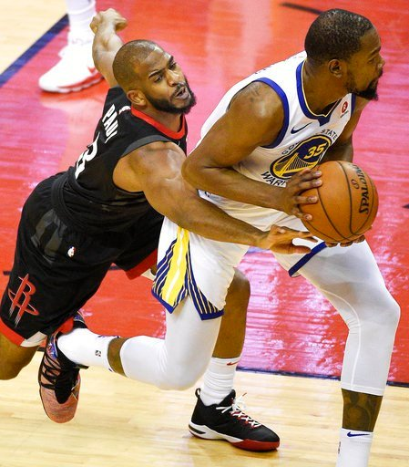 (AP Photo/Eric Christian Smith). Houston Rockets guard Chris Paul, left, reaches for the ball held by Golden State Warriors forward Kevin Durant during the first half of Game 2 of the NBA basketball playoffs Western Conference finals Wednesday, May 16,...