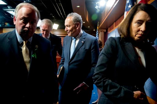 (AP Photo/Andrew Harnik). From left, Rep. Mike Doyle, D-Pa., Sen. Ed Markey, D-Mass., Senate Minority Leader Sen. Chuck Schumer of N.Y., and Sen. Maria Cantwell, D-Wash., leave a news conference on Capitol Hill in Washington, Wednesday, May 16, 2018.