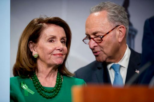 (AP Photo/Andrew Harnik). Senate Minority Leader Sen. Chuck Schumer of N.Y., right, and House Minority Leader Nancy Pelosi of Calif., left, speak together during a news conference on Capitol Hill in Washington, Wednesday, May 16, 2018.
