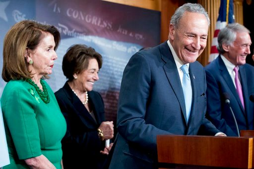 (AP Photo/Andrew Harnik) Senate Minority Leader Sen. Chuck Schumer of N.Y., accompanied by Sen. Ed Markey, D-Mass., right, Rep. Anna Eshoo, D-Calif., second from left, and House Minority Leader Nancy Pelosi of Calif., left, laugh during a news conference.