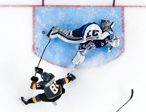 (AP Photo/John Locher). Vegas Golden Knights center Jonathan Marchessault scores past Winnipeg Jets goaltender Connor Hellebuyck during the first period of Game 3 of the NHL hockey playoffs Western Conference finals Wednesday, May 16, 2018, in Las Vegas.