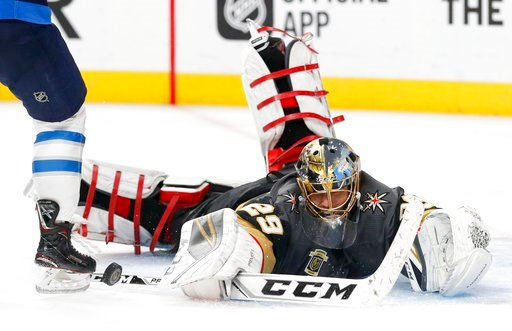 (AP Photo/John Locher). Vegas Golden Knights goaltender Marc-Andre Fleury makes a save against the Winnipeg Jets during the third period of Game 3 of the NHL hockey playoffs Western Conference finals, Wednesday, May 16, 2018, in Las Vegas.