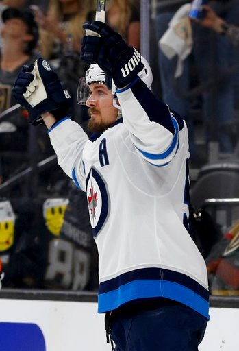(AP Photo/John Locher). Winnipeg Jets center Mark Scheifele celebrates after scoring against the Vegas Golden Knights during the third period of Game 3 of the NHL hockey playoffs Western Conference finals, Wednesday, May 16, 2018, in Las Vegas.