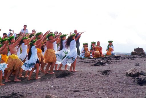 (AP Photo/David Jordan, File). FILE - In this April 23, 2003 file photo, members of the Hula Na Mamo O Pu'uanahulu hula school perform a hula for Pele, the Hawaiin goddess of the volcano, on the rim of Kilauea Volcano in Hawai'i Volcanoes National Park...