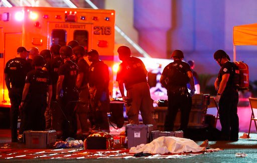 (Steve Marcus /Las Vegas Sun via AP, File). FILE - In this Oct. 1, 2017, file photo, a body is covered with a sheet after a mass shooting in which dozens were killed at a music festival on the Las Vegas Strip in Las Vegas. Witness accounts of gunfire, ...