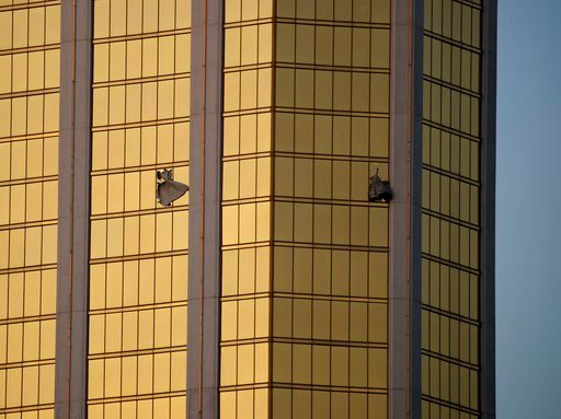 (AP Photo/John Locher, File). FILE - In this Monday, Oct. 2, 2017 file photo, drapes billow out of broken windows at the Mandalay Bay resort and casino on the Las Vegas Strip, following a mass shooting at a music festival in Las Vegas. Police in Las Ve...