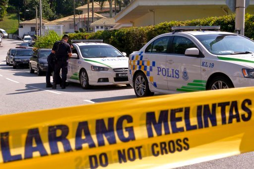 (AP Photo/Sadiq Asyraf). An entrance road to the resident of former Malaysian Prime Minister Najib Razak is cordoned off in Kuala Lumpur, Malaysia, Thursday, May 17, 2018. Malaysian police spent hours early Thursday searching former Prime Minister Naji...