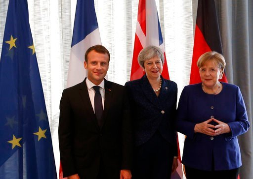 (AP Photo/Darko Vojinovic). German Chancellor Angela Merkel, right, French President Emmanuel Macron, left, and British Prime Minister Theresa May pose prior meeting at a hotel on the sidelines of an EU-Western Balkans summit in Sofia, Bulgaria, Thursd...