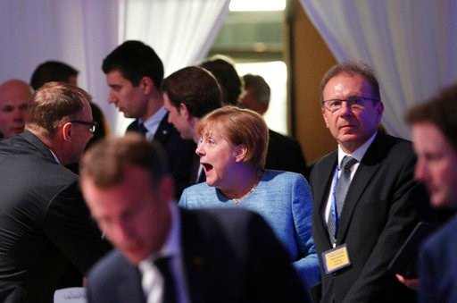 (Stoyan Nenov, Pool Photo via AP). German Chancellor Angela Merkel, center, arrives for a dinner with EU and Western Balkan heads of state at the Sofia Tech Park in Sofia, Bulgaria, Wednesday, May 16, 2018.