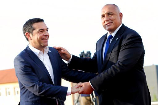 (Stoyan Nenov, Pool Photo via AP). Greek Prime Minister Alexis Tsipras, left, is greeted by Bulgarian Prime Minister Boyko Borissov as he arrives for a dinner with EU and Western Balkan heads of state at the Sofia Tech Park in Sofia, Bulgaria, Wednesda...