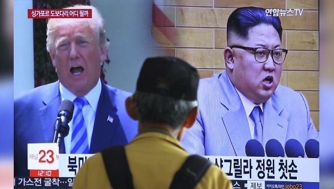 In this May 13, 2018, photo, a man watches a TV screen showing file footage of U.S. President Donald Trump, left, and North Korean leader Kim Jong Un during a news program at the Seoul Railway Station in Seoul, South Korea. (AP Photo/Ahn Young-joon, File)