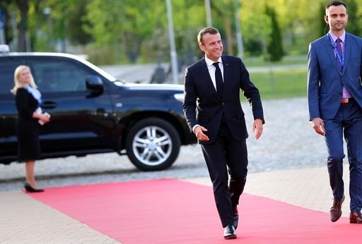 (Stoyan Nenov, Pool Photo via AP). French President Emmanuel Macron arrives for a dinner with EU and Western Balkan heads of state at the Sofia Tech Park in Sofia, Bulgaria, Wednesday, May 16, 2018.