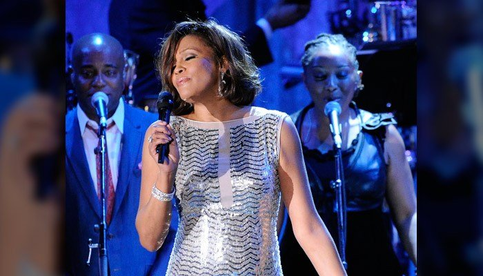 In this Feb. 13, 2011, file photo, singer Whitney Houston performs at the pre-Grammy gala & salute to industry icons with Clive Davis honoring David Geffen in Beverly Hills, Calif. (AP Photo/Mark J. Terrill, File)