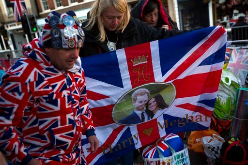 (AP Photo/Emilio Morenatti). People who spent the night outside Windsor Castle in Windsor, England, organise their belongings after waking up, early Thursday, May 17, 2018. Preparations continue in Windsor ahead of the royal wedding of Britain's Prince...