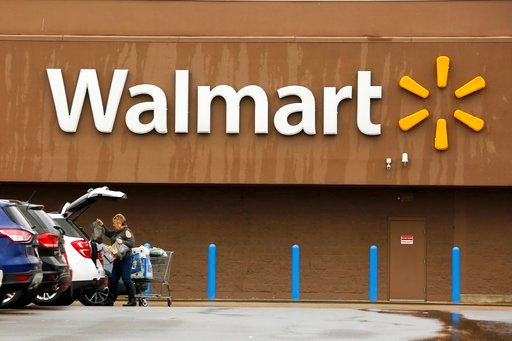 (AP Photo/Gene J. Puskar, File). FILE- In this Feb. 22, 2018, file photo, a shopper loads her car after shopping at a Walmart in Pittsburgh. Walmart Inc. reports earnings on Thursday, May 17, 2018.