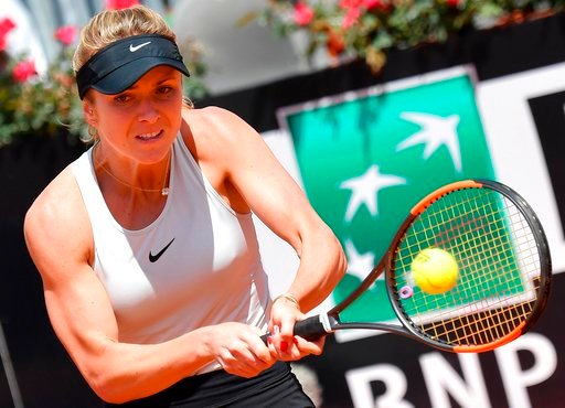 (Ettore Ferrari/ANSA via AP). Elina Svitolina, of Ukraine, returns the ball to Daria Kasatkina, of Russia, at the Italian Open tennis tournament in Rome, Thursday, May 17, 2018.