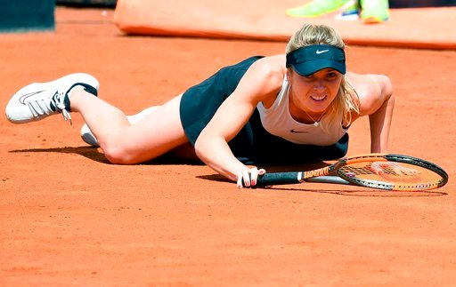 (Ettore Ferrari/ANSA via AP). Elina Svitolina, of Ukraine, falls during her match against Daria Kasatkina, of Russia, at the Italian Open tennis tournament in Rome, Thursday, May 17, 2018.