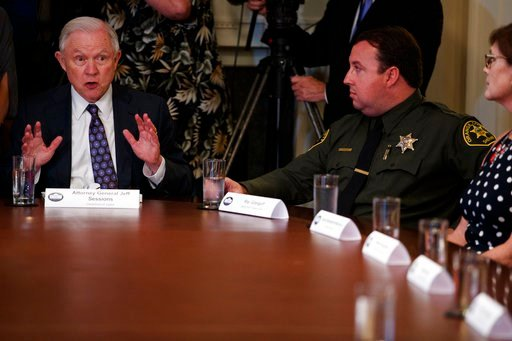 (AP Photo/Evan Vucci). Attorney General Jeff Sessions speaks during a roundtable on immigration policy in California, in the Cabinet Room of the White House, Wednesday, May 16, 2018, in Washington.
