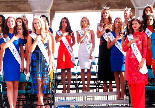 (AP Photo/Wayne Parry). In this Aug. 30, 2017 photo contestants attend a welcoming ceremony for the Miss America competition on the Atlantic City, N.J., Boardwalk. On Thursday, May 17, 2018, the Miss America Organization announced it has installed wome...