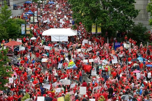 (AP Photo/Gerry Broome). Educators fill Bicentennial Plaza during a teachers rally at the General Assembly in Raleigh, N.C., Wednesday, May 16, 2018. Thousands of teachers rallied the state capital seeking a political showdown over wages and funding fo...