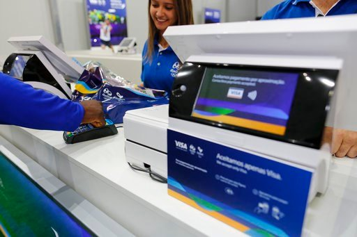 (Leo Correa/AP Images for Visa). In this June 30, 2016, image taken by AP Images for Visa, Team Visa athlete Popole Misenga uses his Visa payment ring at the Copacabana Megastore in Rio de Janeiro, Brazil.  Payment networks and manufacturers are buildi...
