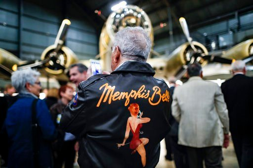 """(AP Photo/John Minchillo). Visitors gather for a private viewing of the Memphis Belle, a Boeing B-17 """"Flying Fortress,"""" at the National Museum of the U.S. Air Force, Wednesday, May 16, 2018, in Dayton, Ohio. The World War II bomber Memphis Belle is set..."""