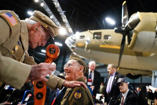"""(AP Photo/John Minchillo). Veterans gather for a private viewing of the Memphis Belle, a Boeing B-17 """"Flying Fortress,"""" at the National Museum of the U.S. Air Force, Wednesday, May 16, 2018, in Dayton, Ohio. The World War II bomber Memphis Belle is set..."""