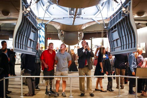 """(AP Photo/John Minchillo). Visitors gather under open bomb-bay doors during a private viewing of the Memphis Belle, a Boeing B-17 """"Flying Fortress,"""" at the National Museum of the U.S. Air Force, Wednesday, May 16, 2018, in Dayton, Ohio. The World War I..."""