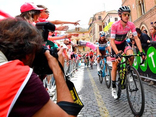 (Daniel Dal Zennaro/ANSA via AP). Britain's Simon Yates wears the pink jersey of the overall leader at the start of the 12th stage of the Giro d'Italia cycling race from Osimo to Imola, Italy, Thursday, May 17, 2018.